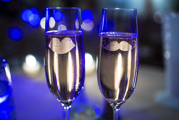 Toasting glasses filled with Je T'aime Brut Rose at the Alister & Paine Wedding