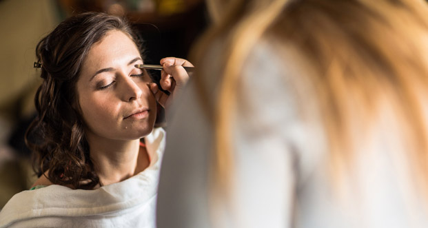 Cynthea Hausman helps our bride get ready on-site at the Trapp Family Lodge